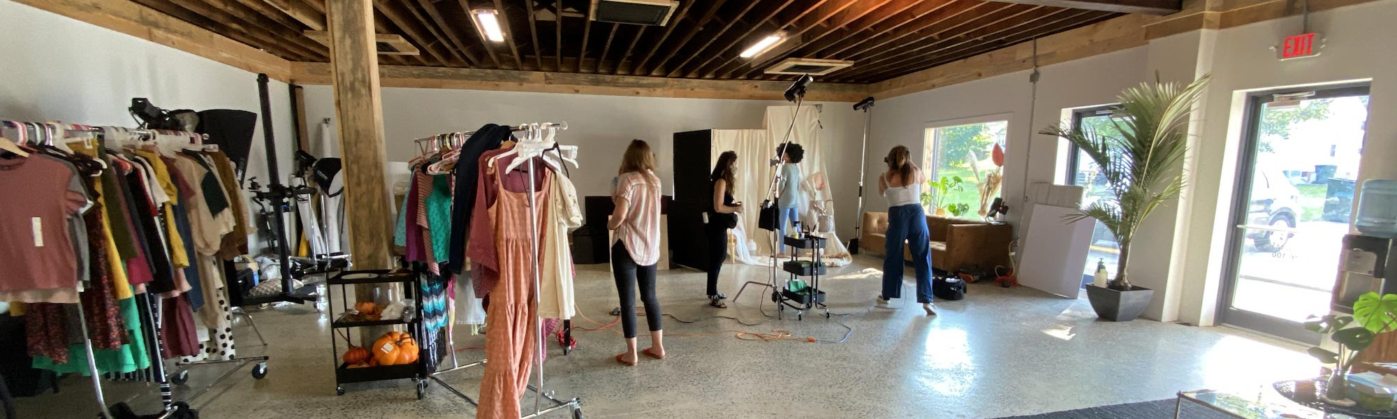 Salt Paper Studio production crew engaged in a fashion shoot in-studio with model, photographer and stylist