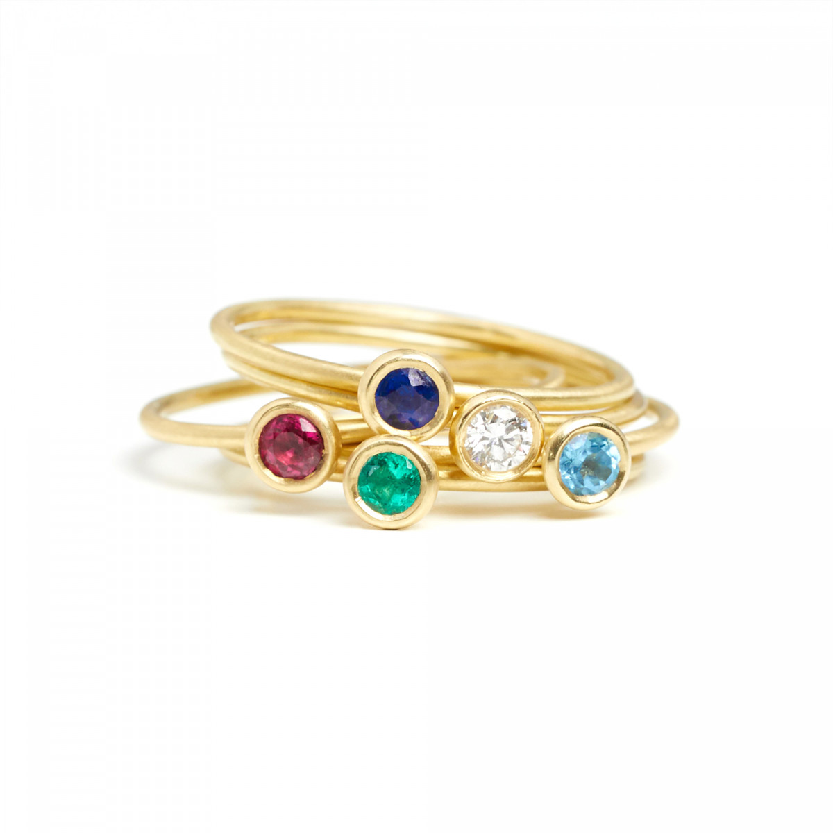 E-commerce photography of gold and gem rings