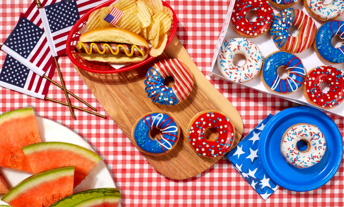 Food product photography of independence day themed Krispy Kreme doughnuts on a picnic table