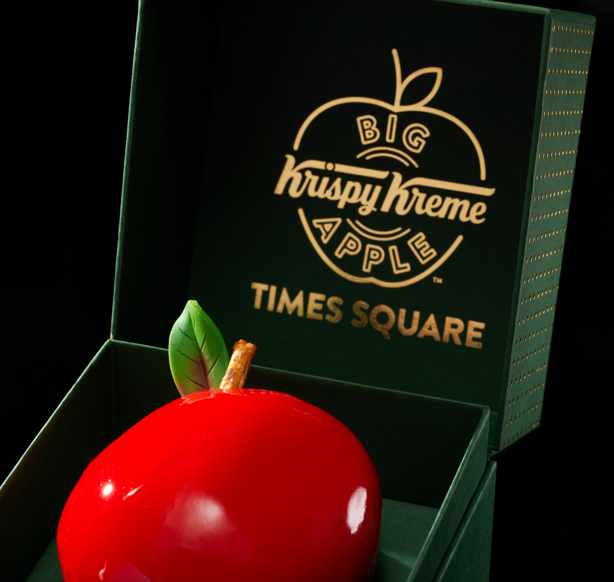 Commercial product photography of Krispy Kreme big red apple confection in a fancy green box