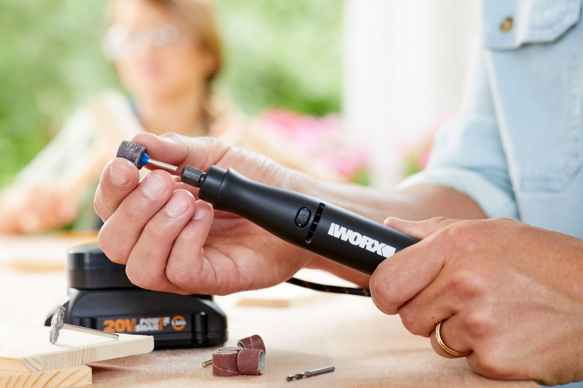 Commercial lifestyle product photography of a woman's hands holding a WORX hot air tool