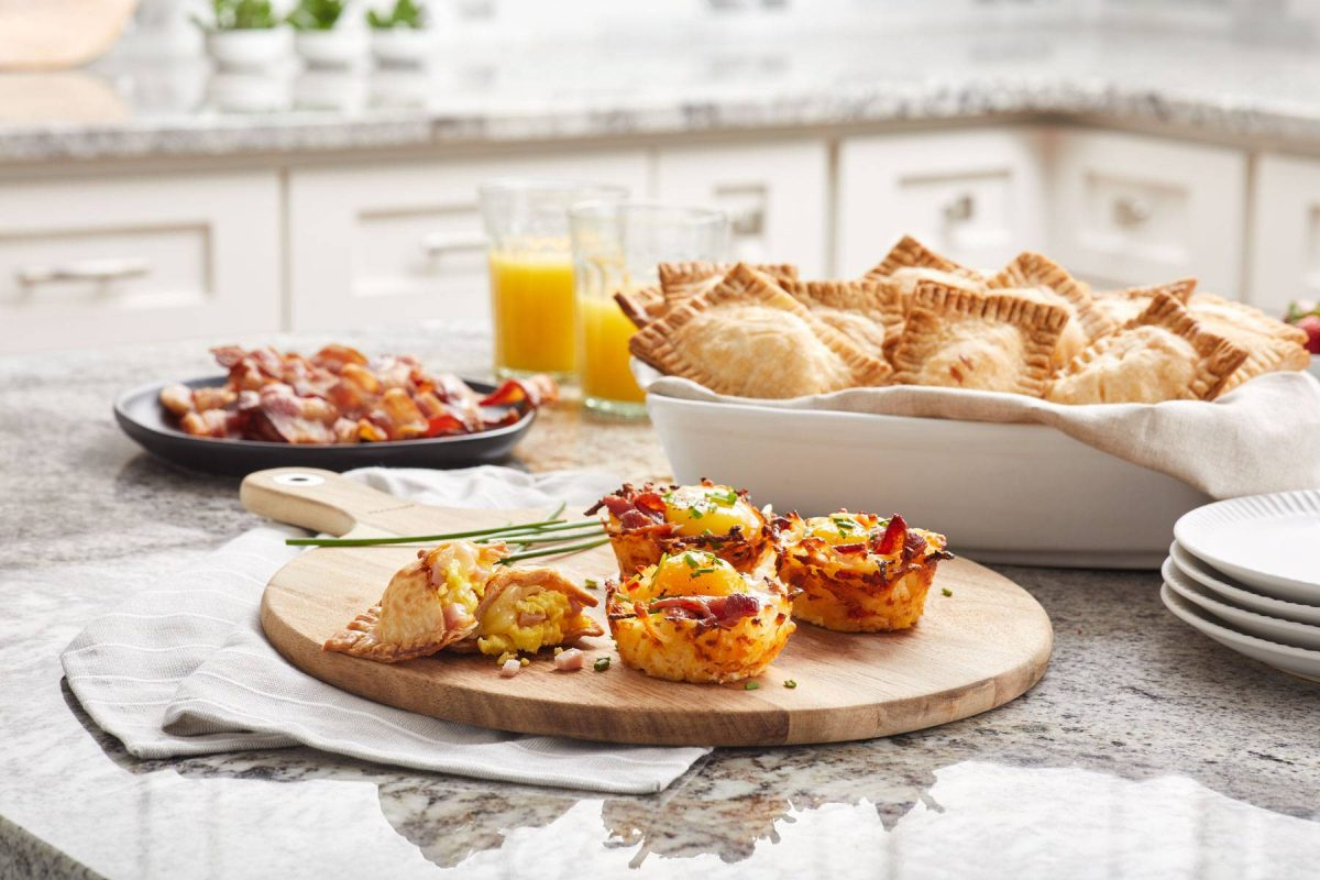 Food lifestyle photo of an assortment of breakfast items on a kitchen counter