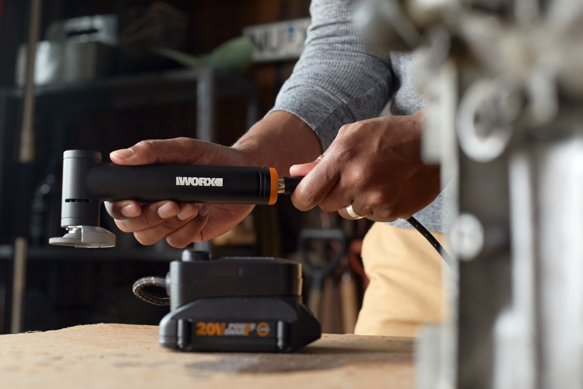 Product photography of a person plugging in a WORX hand tool