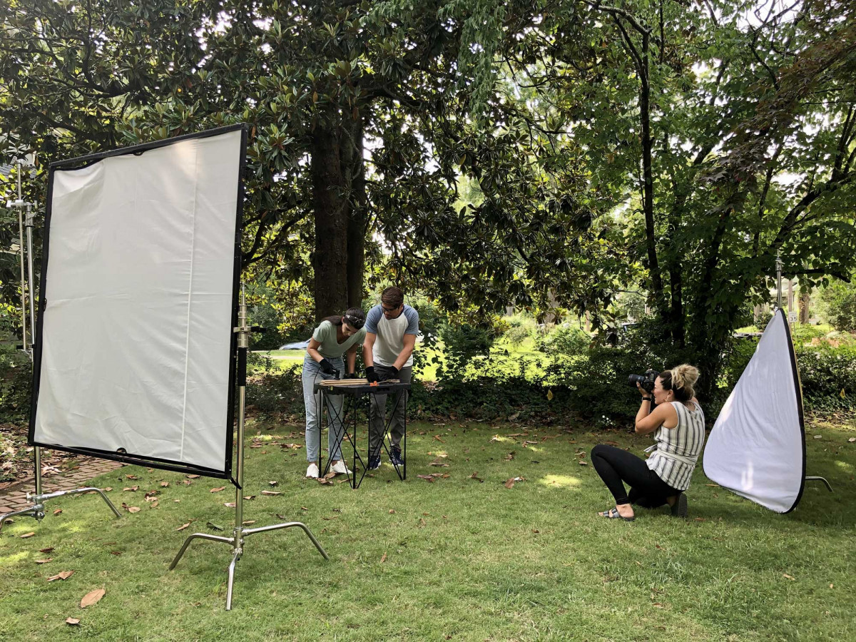 Professional photographer working on a lifestyle product photography shoot outdoors