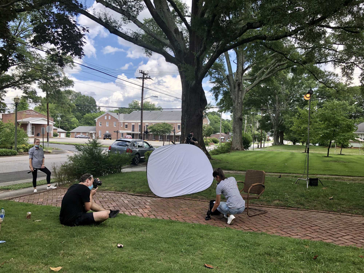 Professional photography crew setting up an outdoor photoshoot