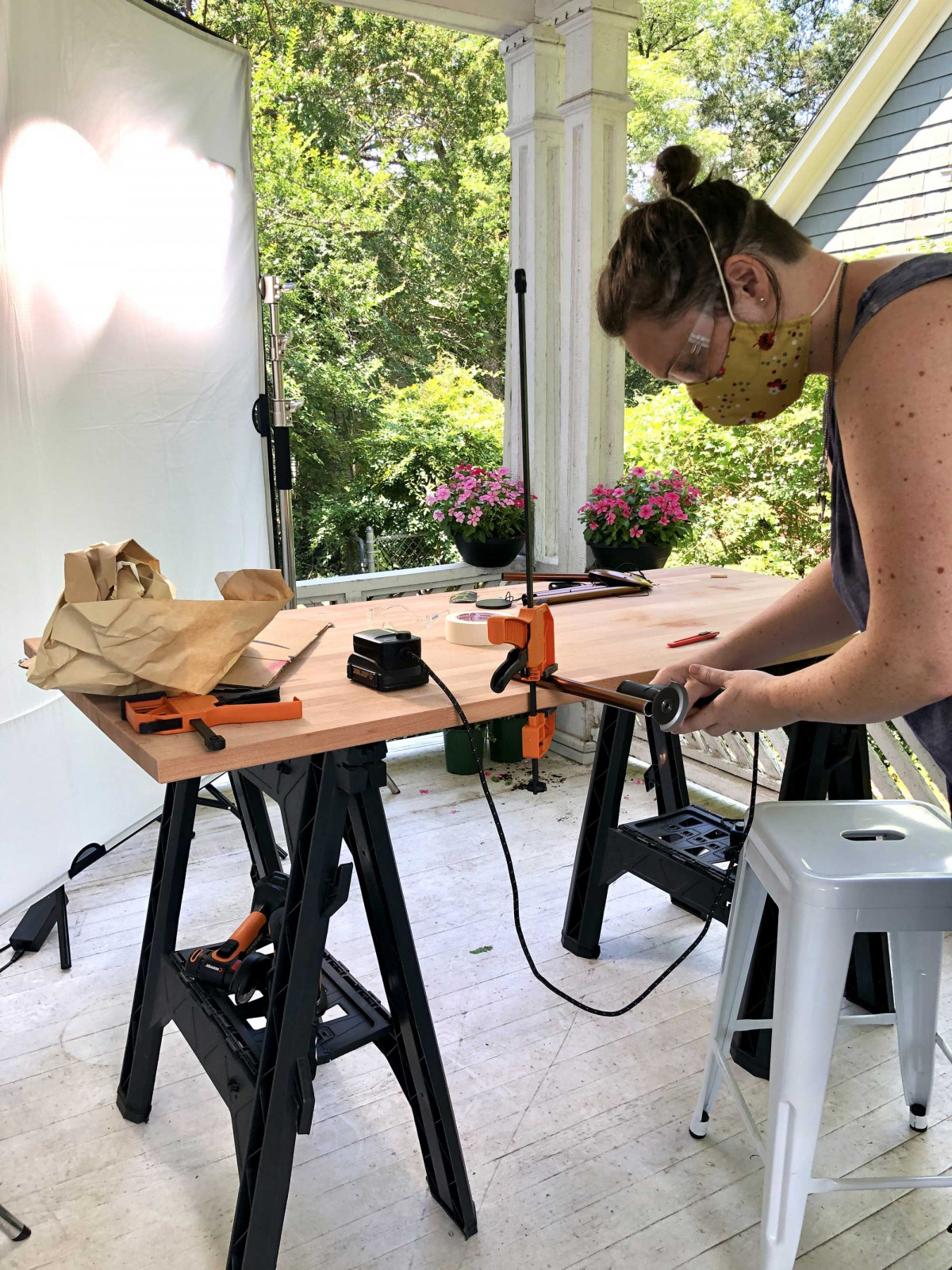 Woman using WORX tools at an outside work bench