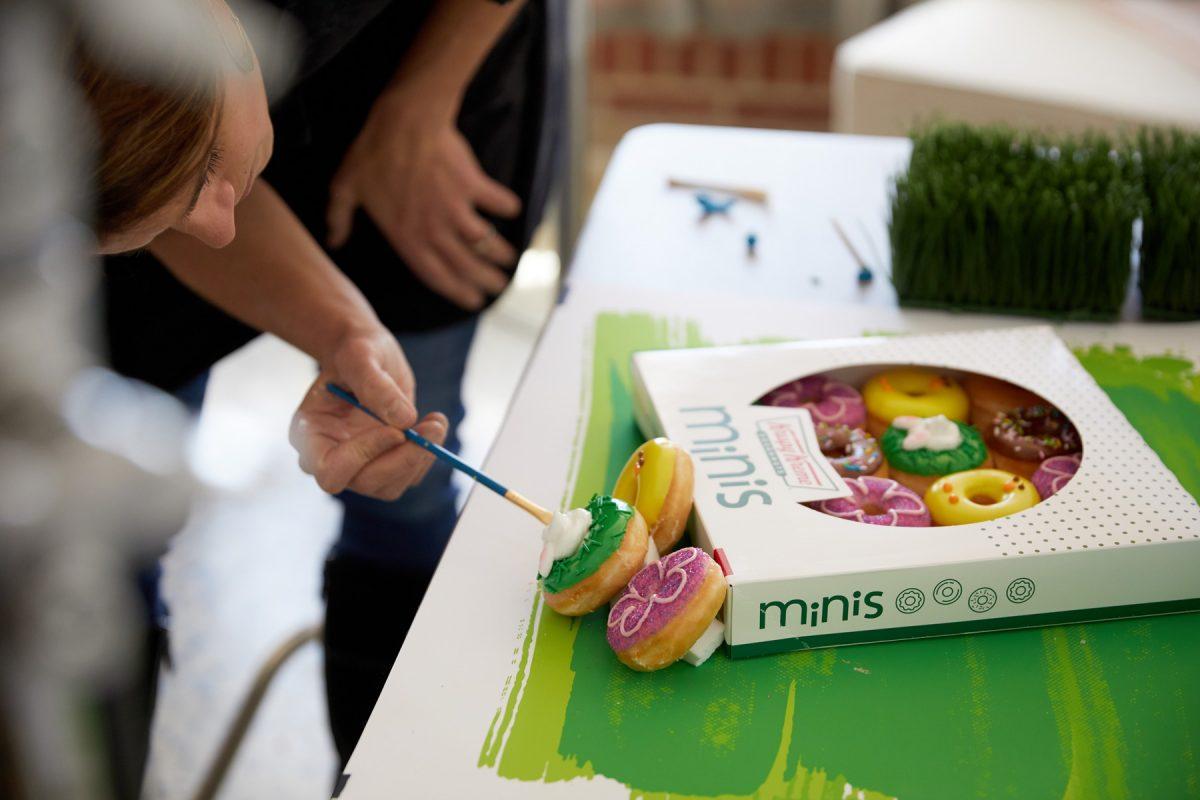 Professional Food Stylist preparing Krispy Kreme Doughnuts for a commercial photo shoot