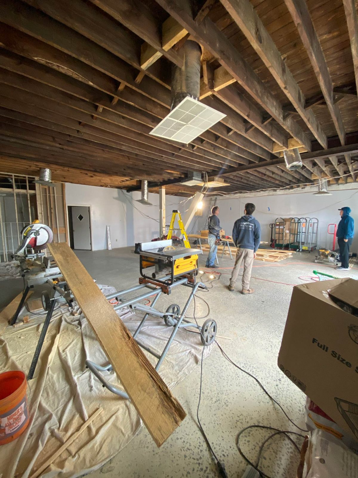 Construction crew working on interior remodel