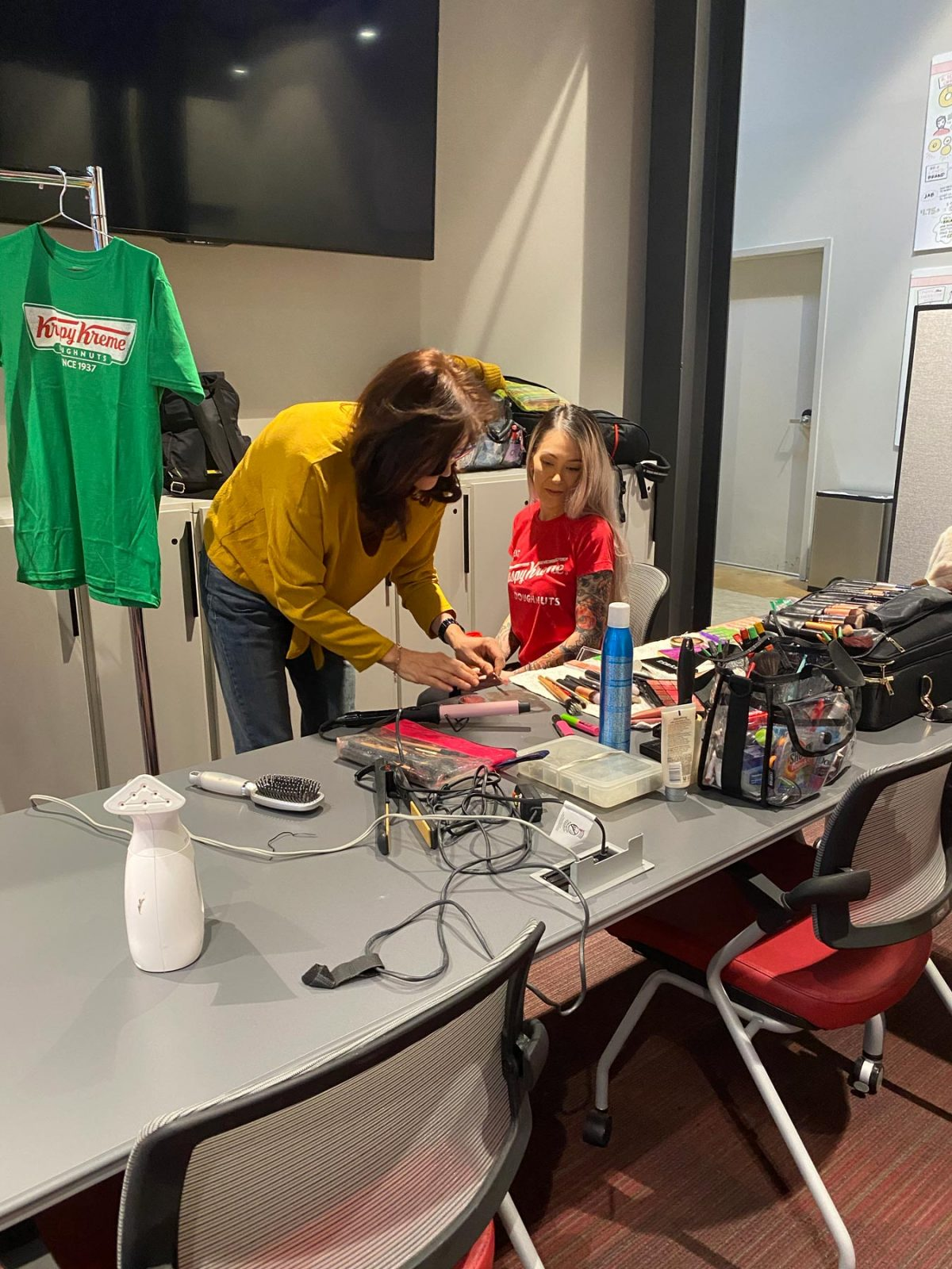 Makeup artist preparing a model for a photo shoot for Krispy Kreme Doughnuts