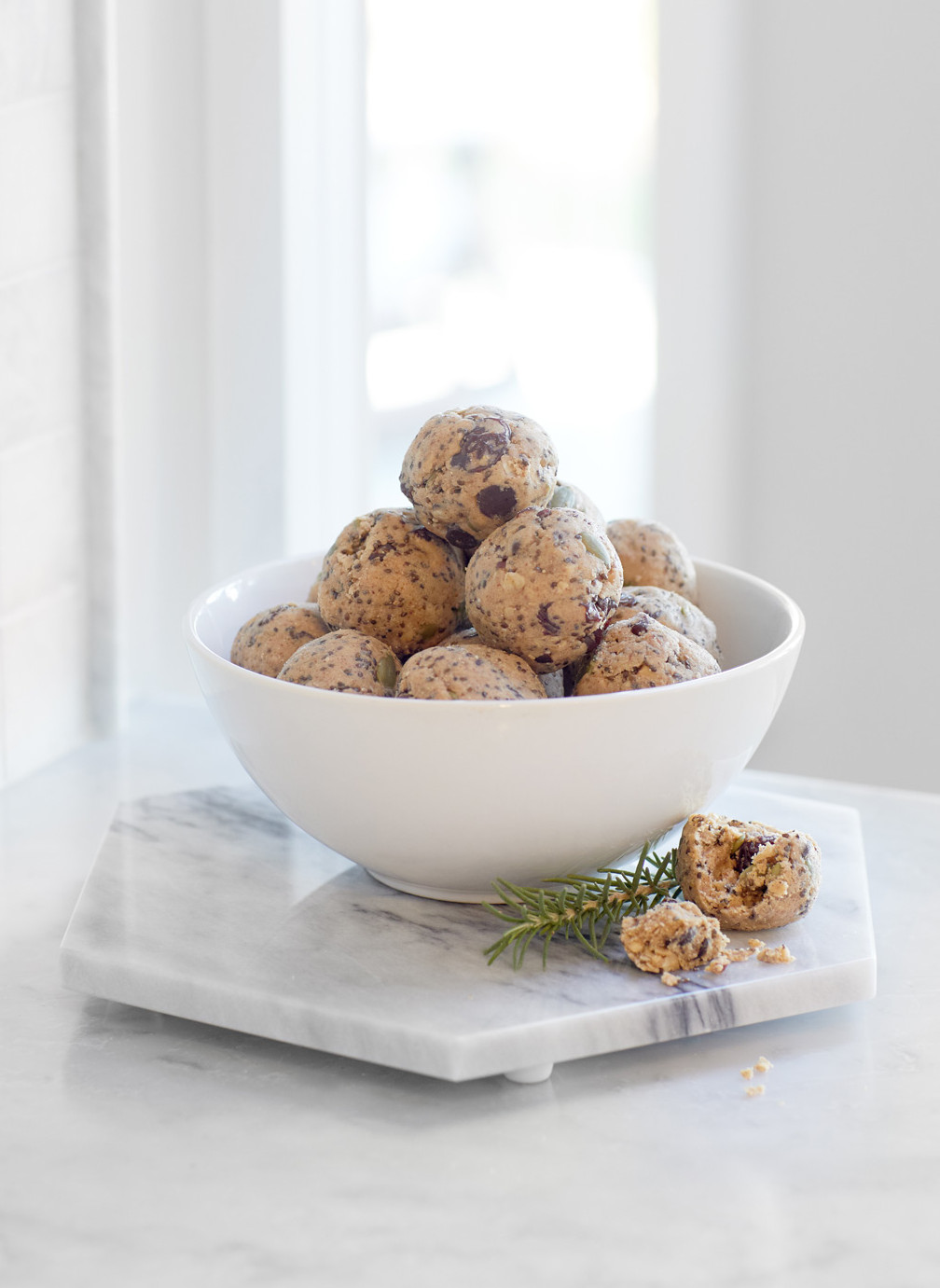 White bowl filled with raw energy balls