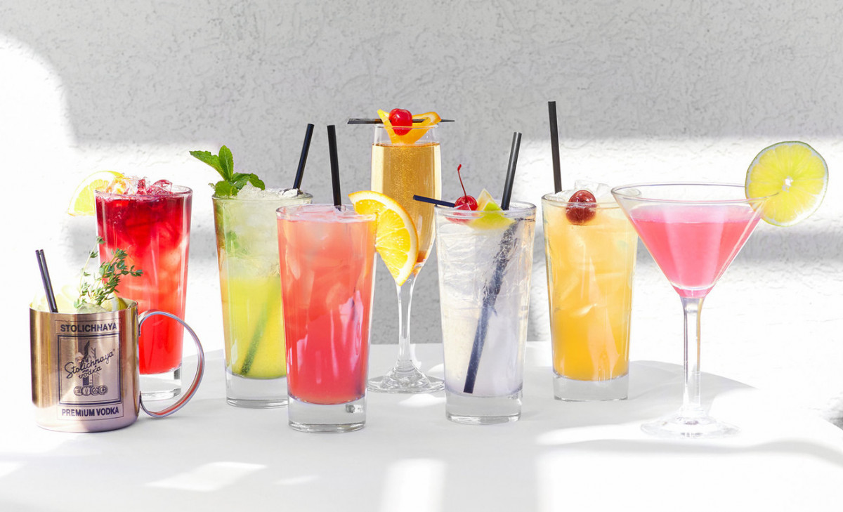 Food and beverage photography of a selection of colorful tropical looking cocktails and mixed drinks