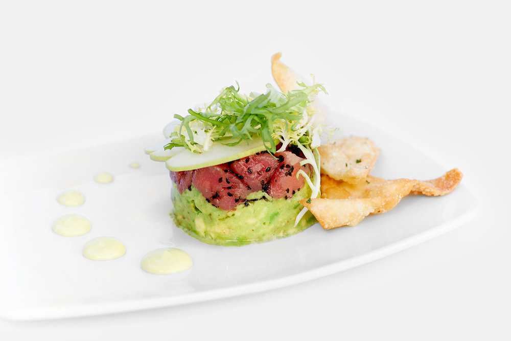 Restaurant food photography of a modern plating of avocado and tuna with microgreens