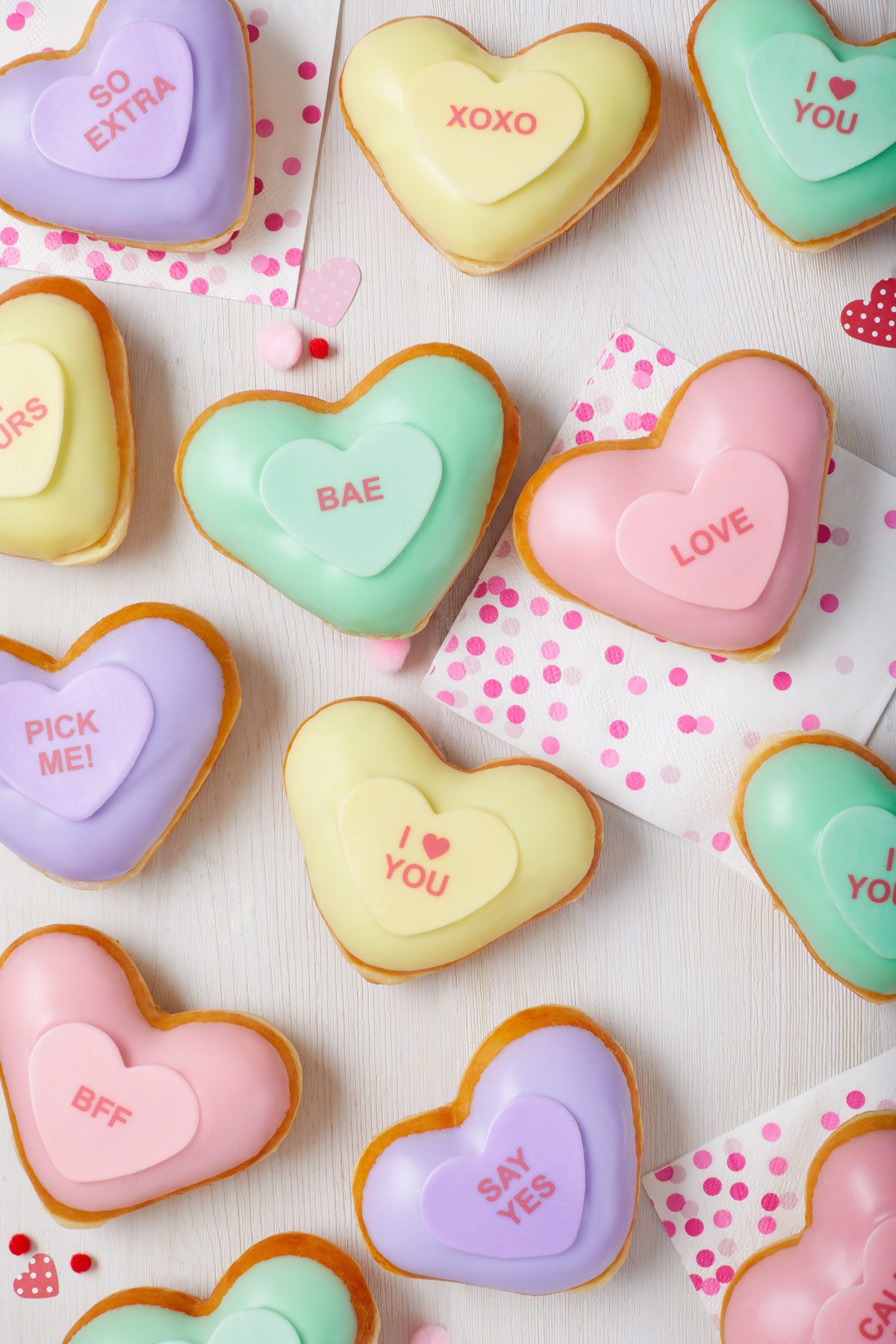 Food product photography of heart-shaped, Valentine's Day themed doughnuts from Krispy Kreme