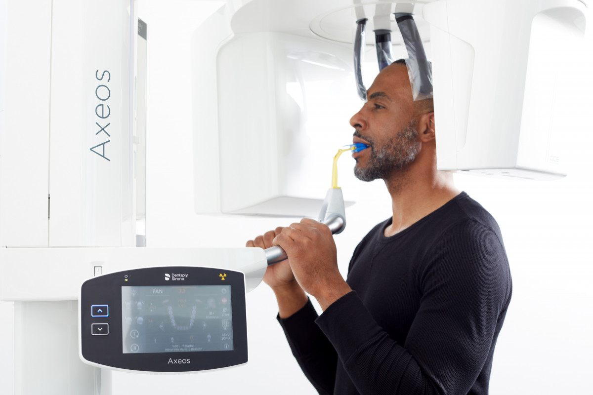 Lifestyle product photography of a male patient using an Axeos imaging machine