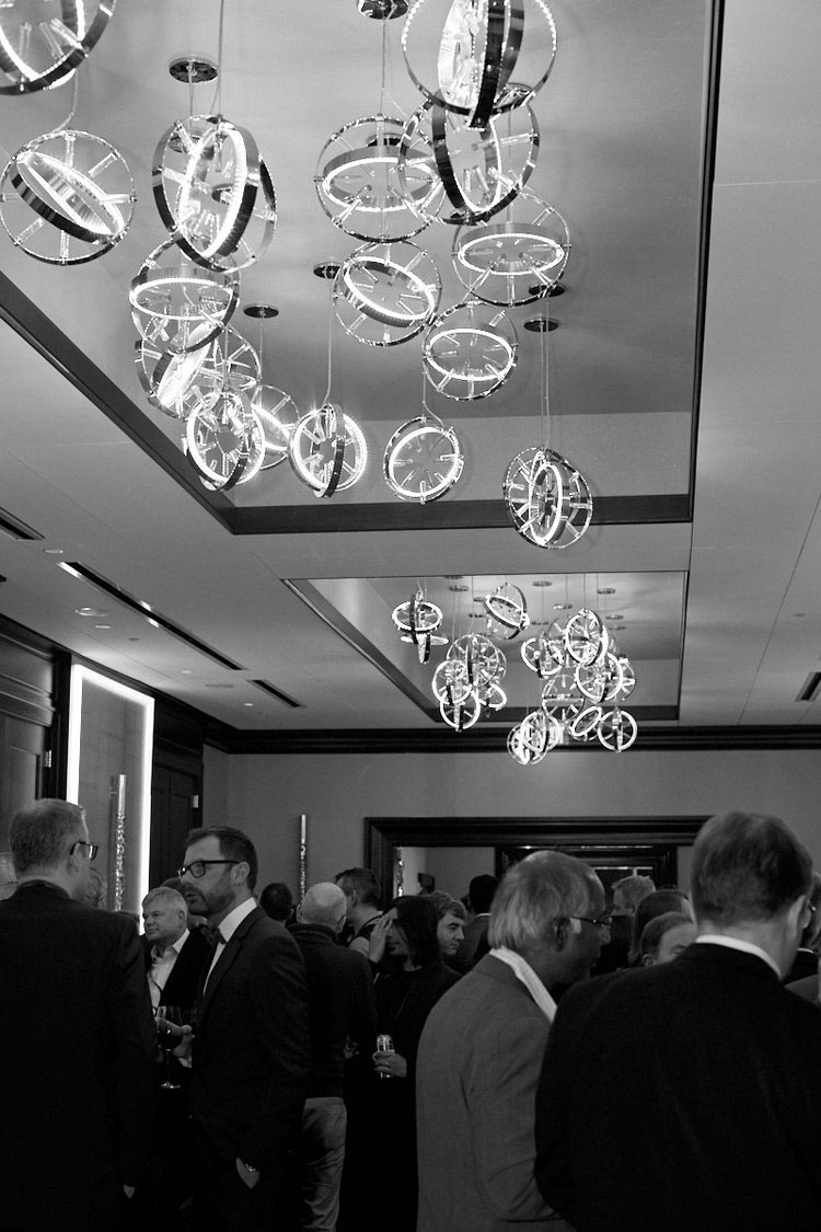 Corporate event photography of people mingling