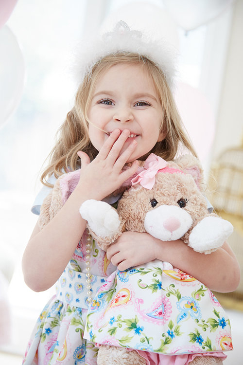 Editorial lifestyle photography of a young girl holding a stuffed bunny