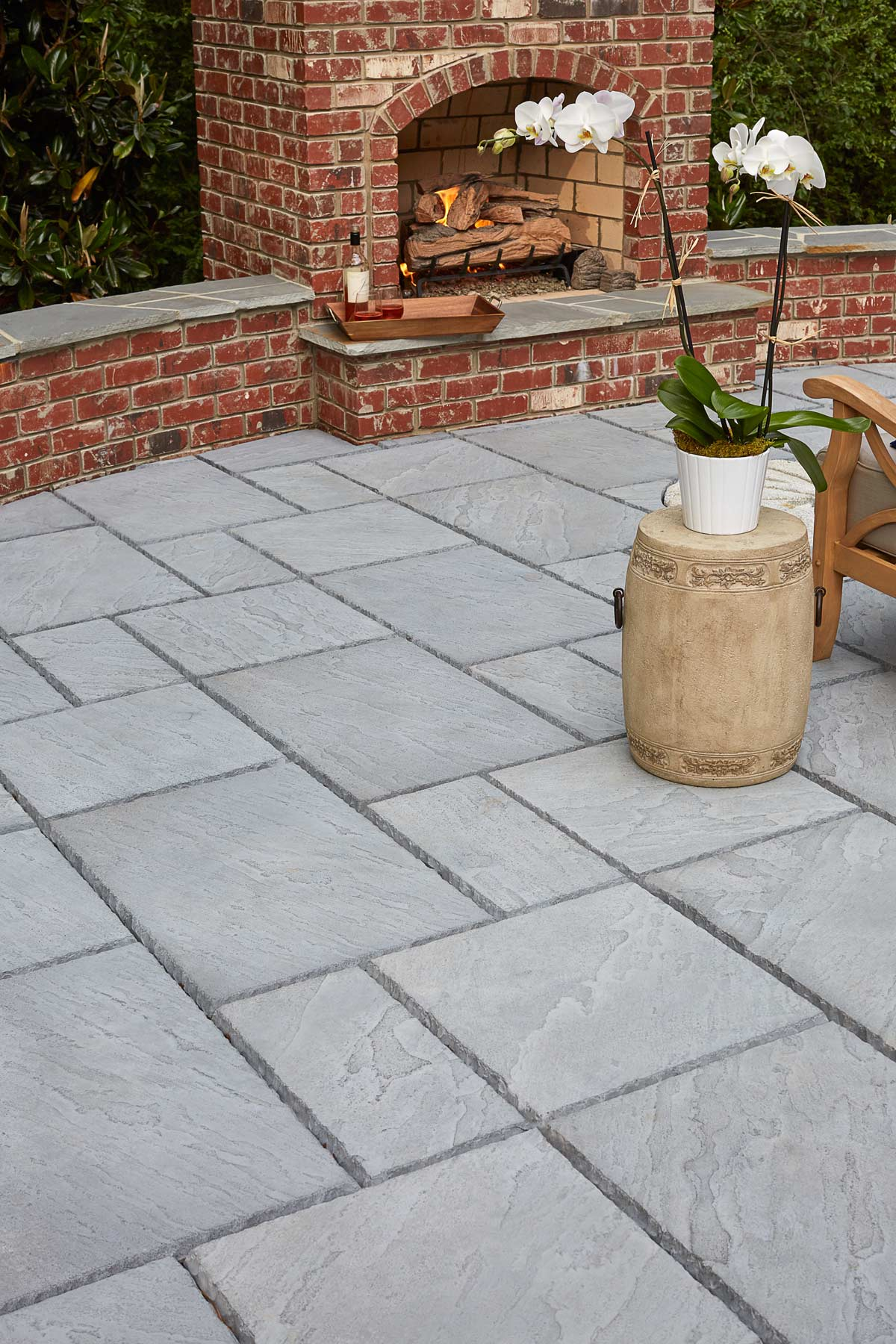 Editorial lifestyle photography of gray stone patio and outdoor fireplace