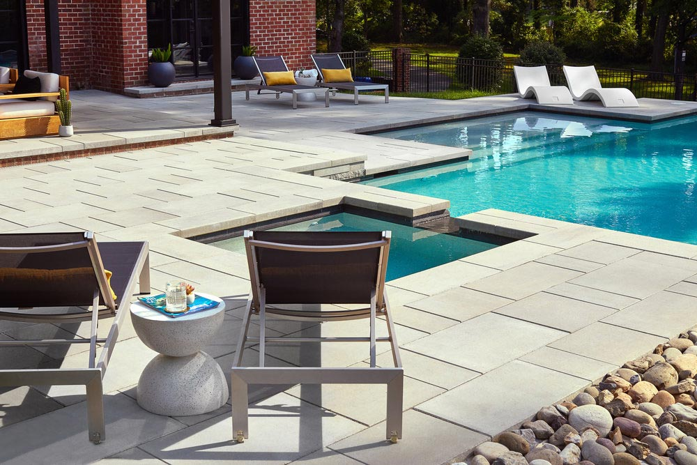 Editorial lifestyle photography of modern backyard pool and patio