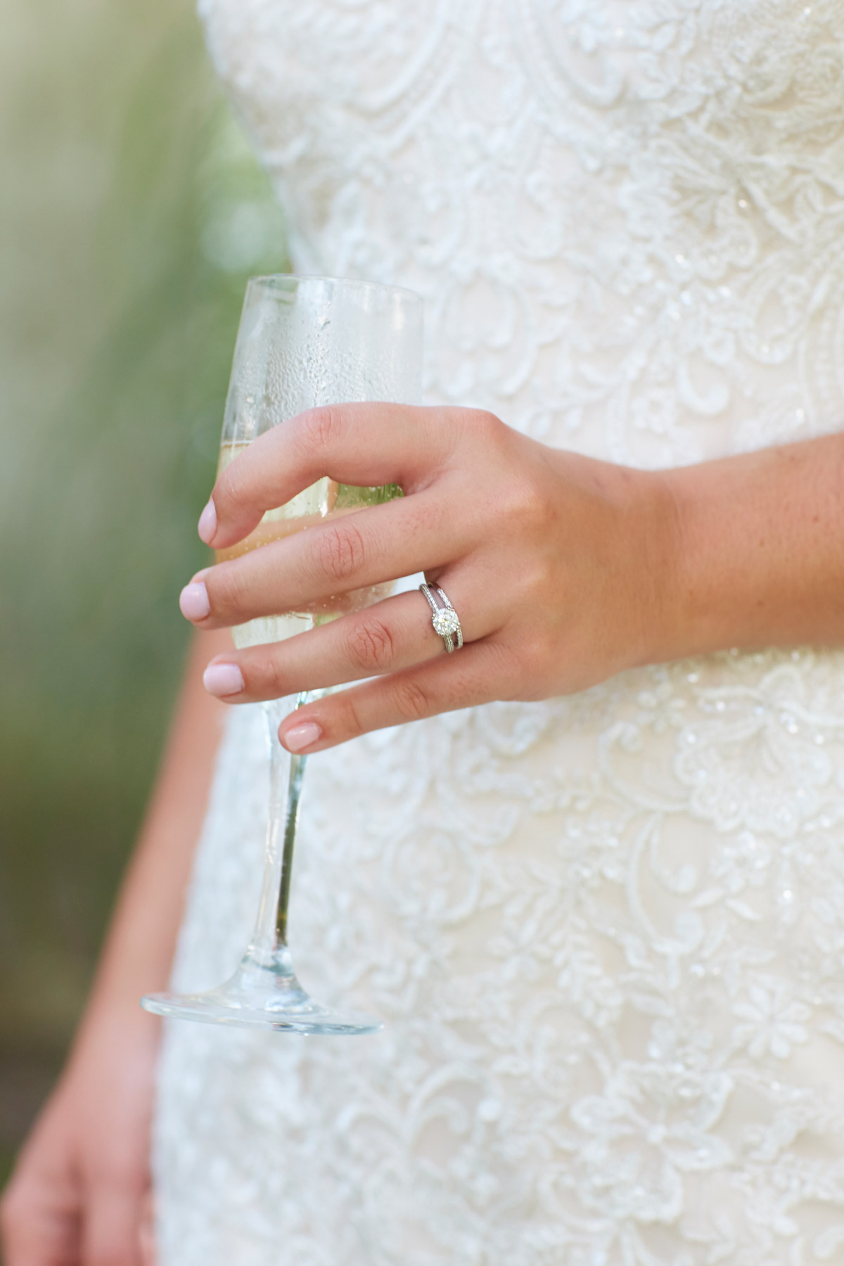 Editorial lifestyle photography of a woman in a wedding dress holding a champagne flute