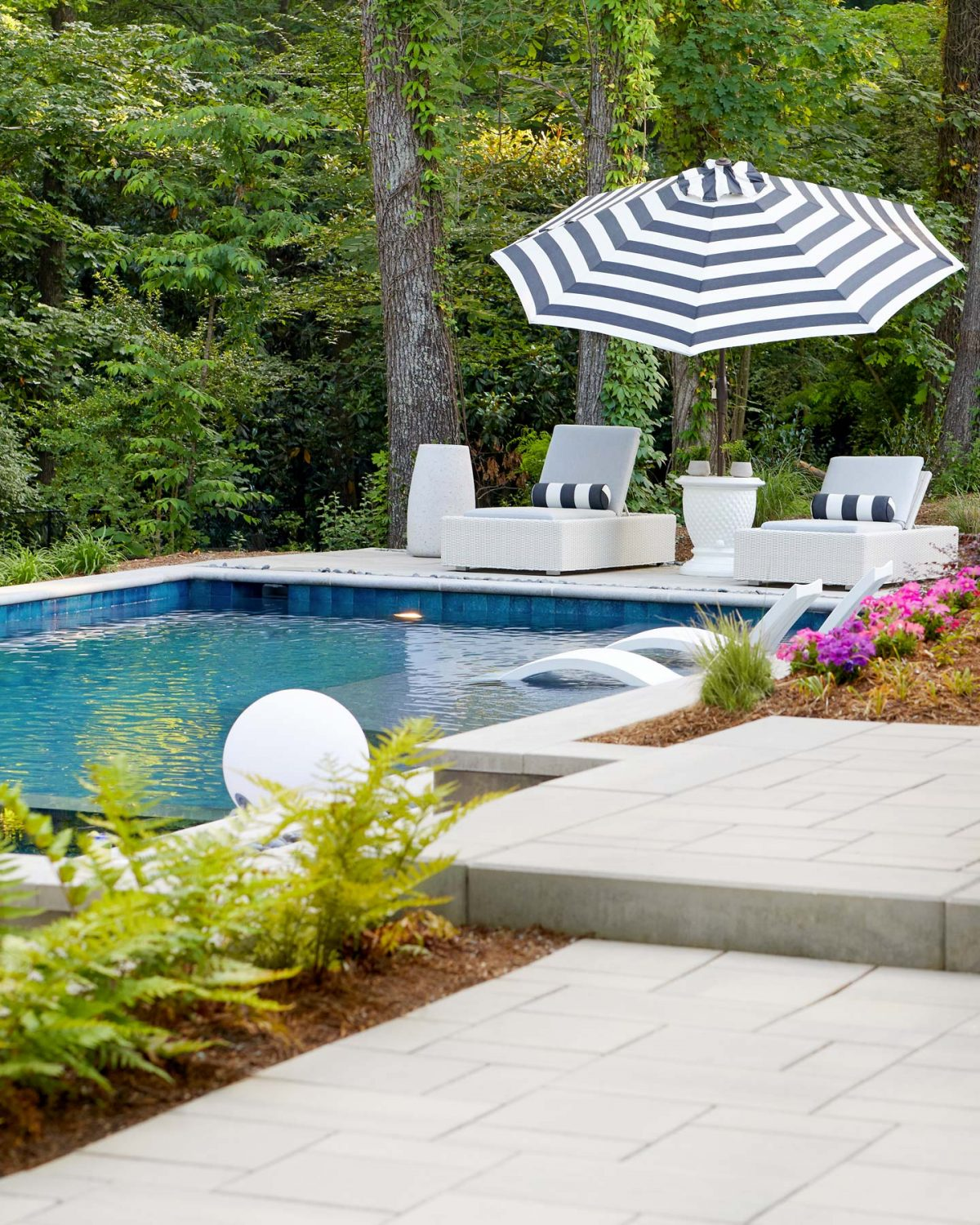 Editorial photography of a modern pool and patio