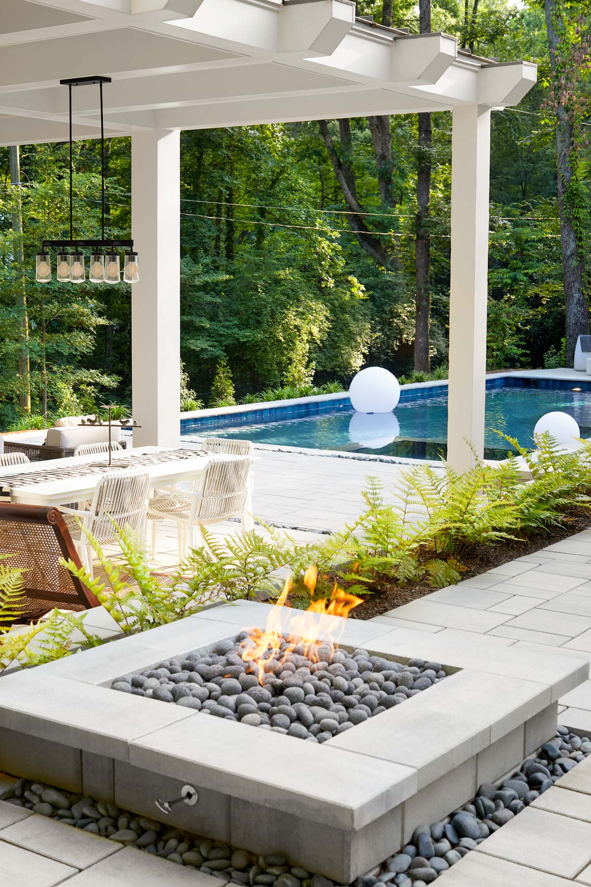 Commercial photography of beautiful outdoor fireplace, pool and patio