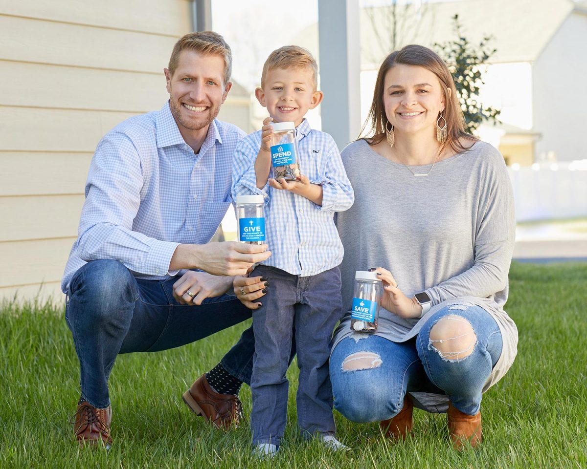 Lifestyle editorial photography of a happy young family outside their home
