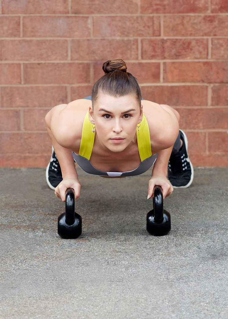 Editorial fitness photography with a female model doing a pushup