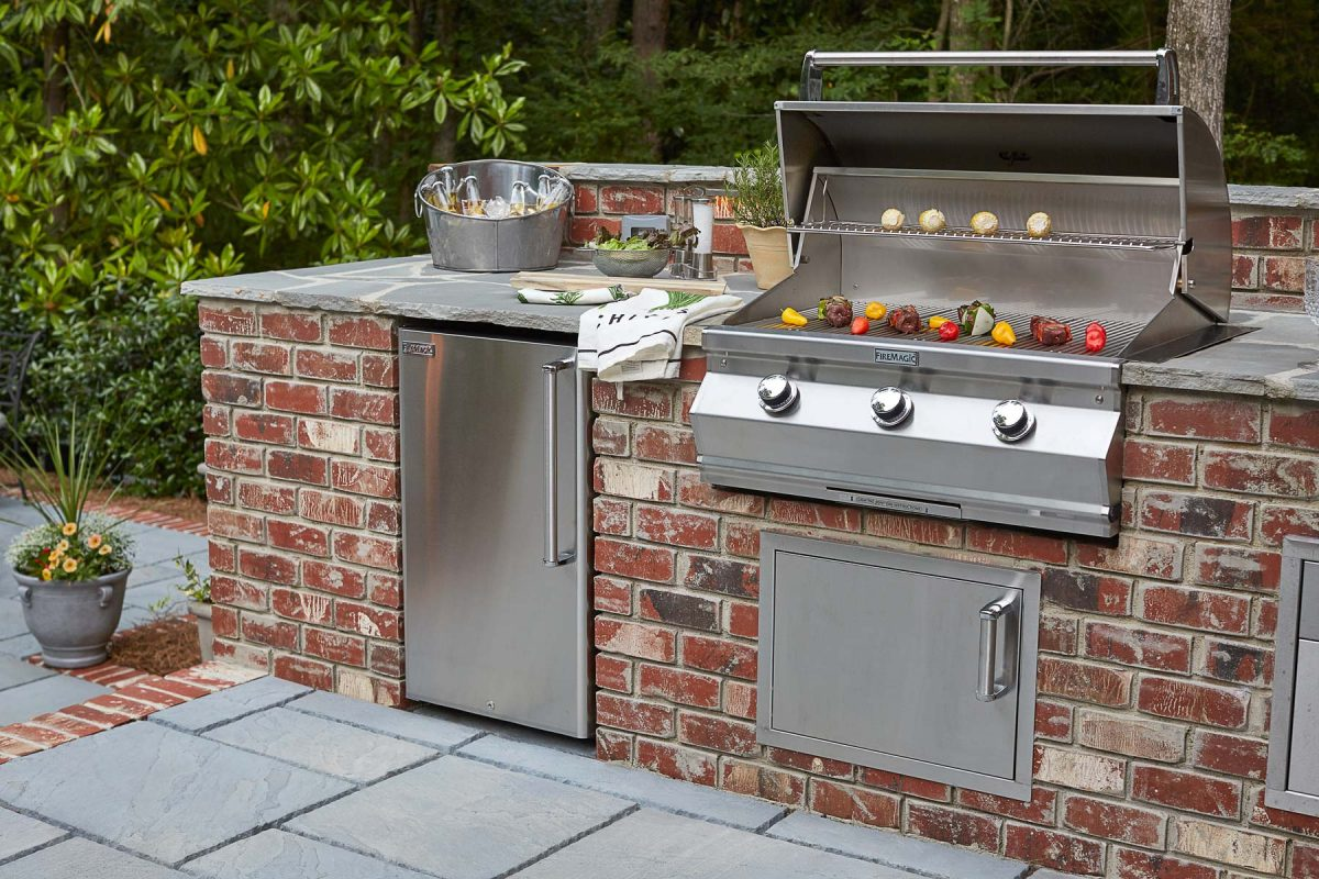 Commercial real estate photography of a luxury outdoor kitchen and grill station