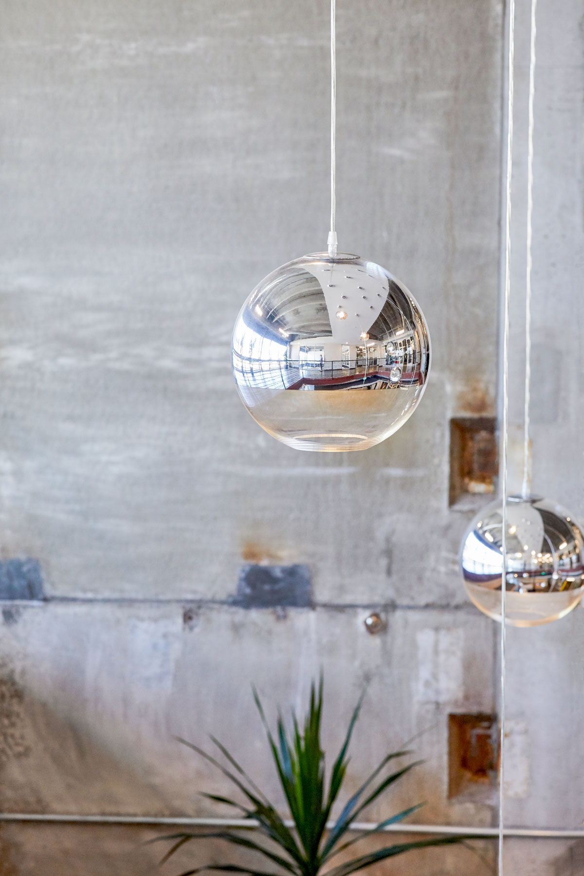 Interior photography of hanging circular accent lights