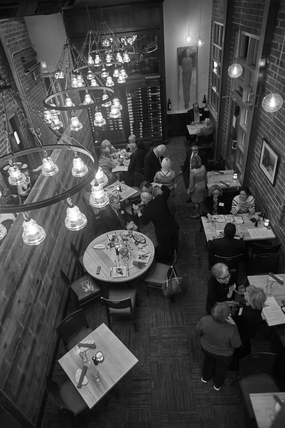 Interior photo in black and white of busy restaurant dining area
