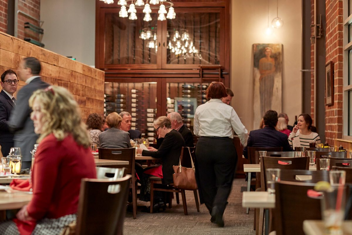 Interior photo of a busy restaurant during dinner rush