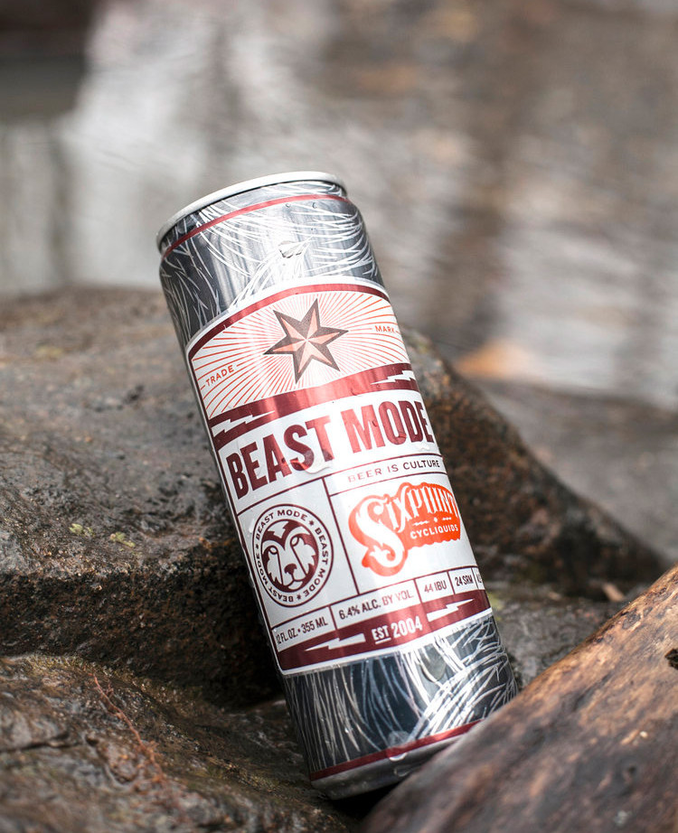 Can of Beast Mode beverage sitting on a rocky outcropping