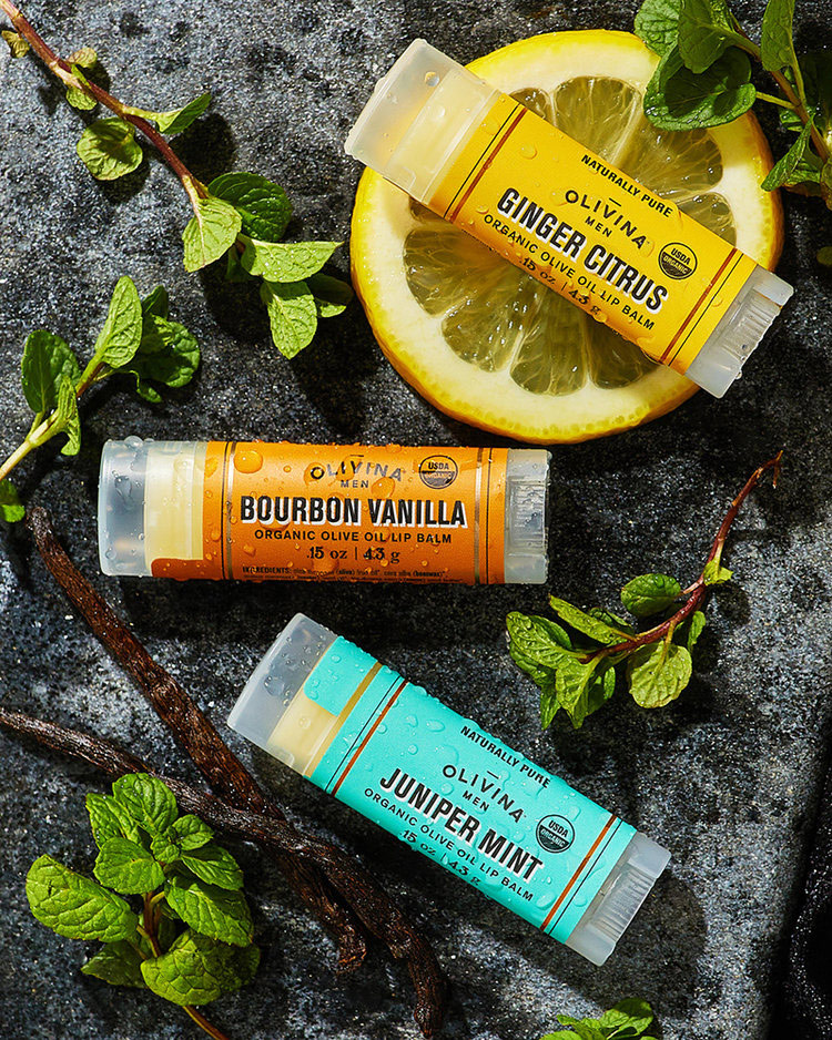 Commercial lifestyle product photography of three tubes of Olivina chapstick