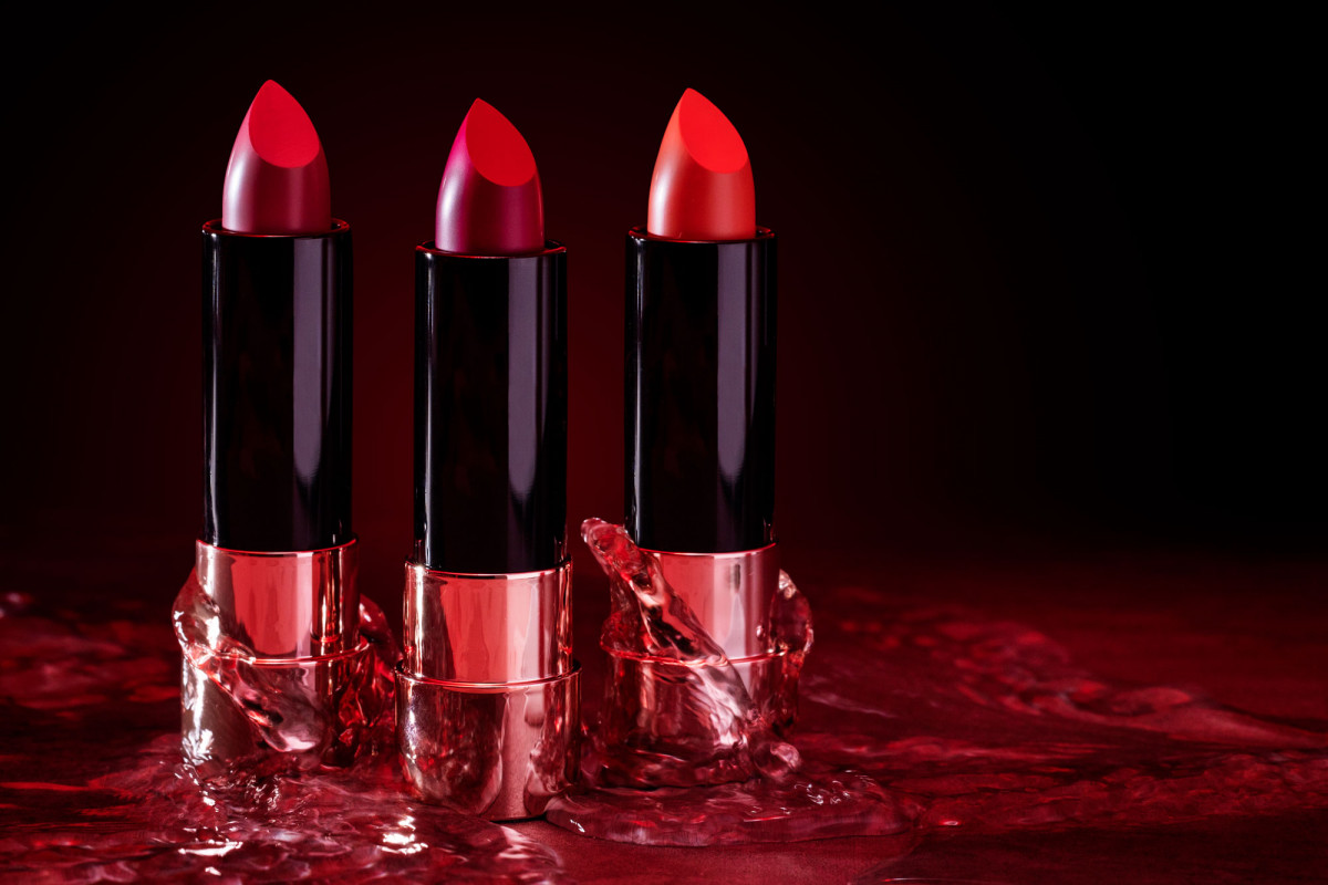 Commercial product photography of three tubes of premium red lipstick